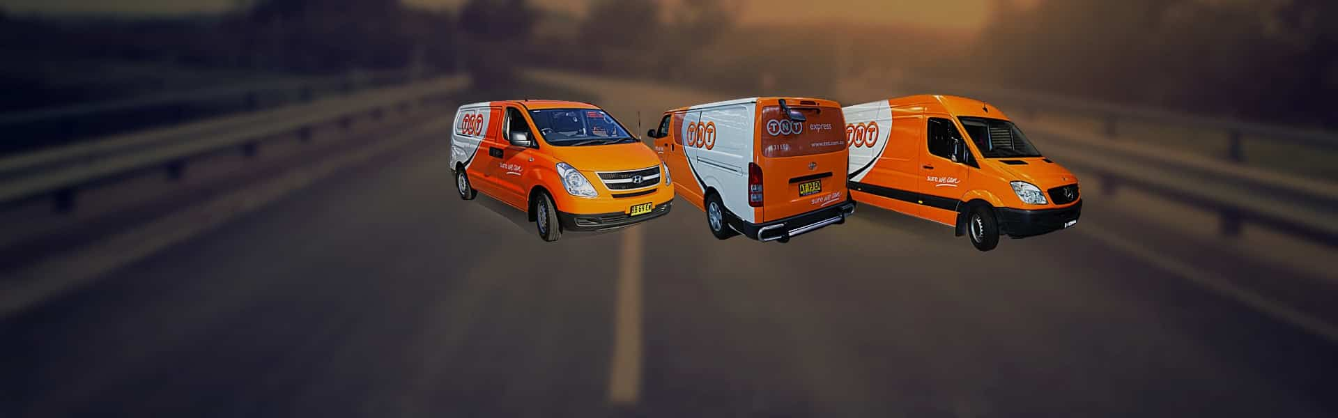 three vans with vehicle wraps